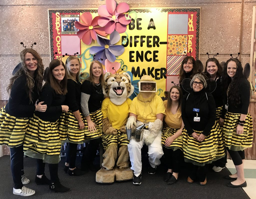 Bob, Mrs. North and support staff in bumblebee costumes