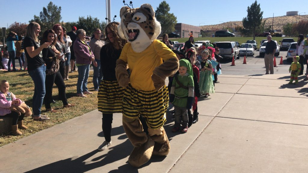 Bob the Bobcat and Mrs. North leading Halloween parade