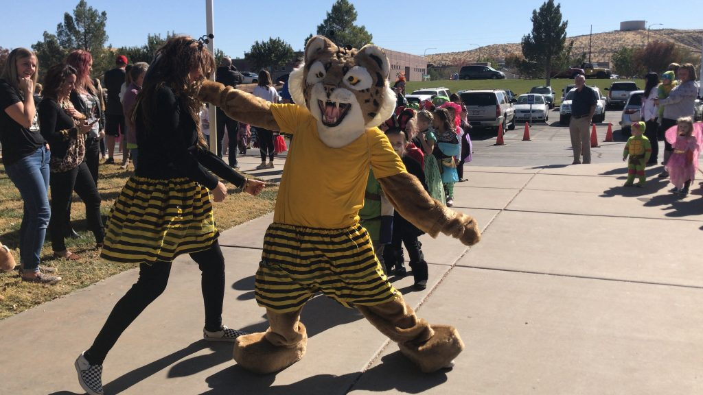 Bob the Bobcat dancing with Mrs. Rogers