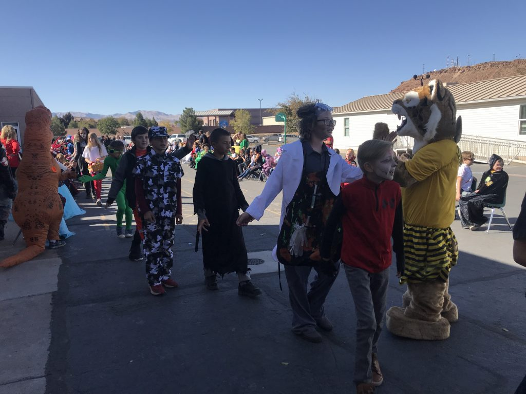 Bob the Bobcats and students in Halloween costumes