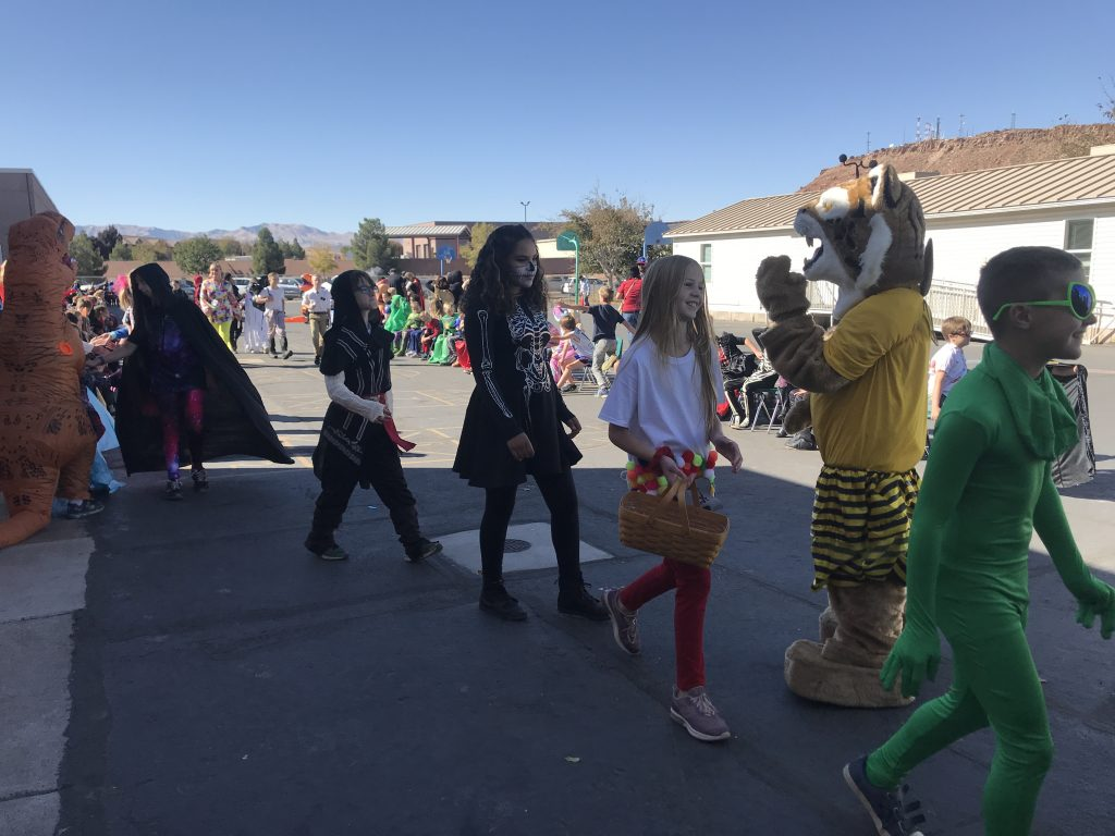 Bob the Bobcat and students in Halloween costume